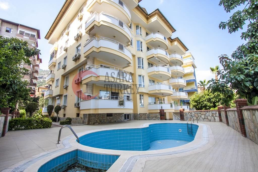 Furnished three-room apartment with pool in the center of Alanya